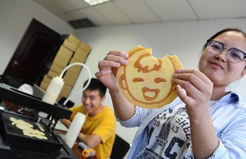 Tsinghua graduates invent 3-D pancake-printing machine
