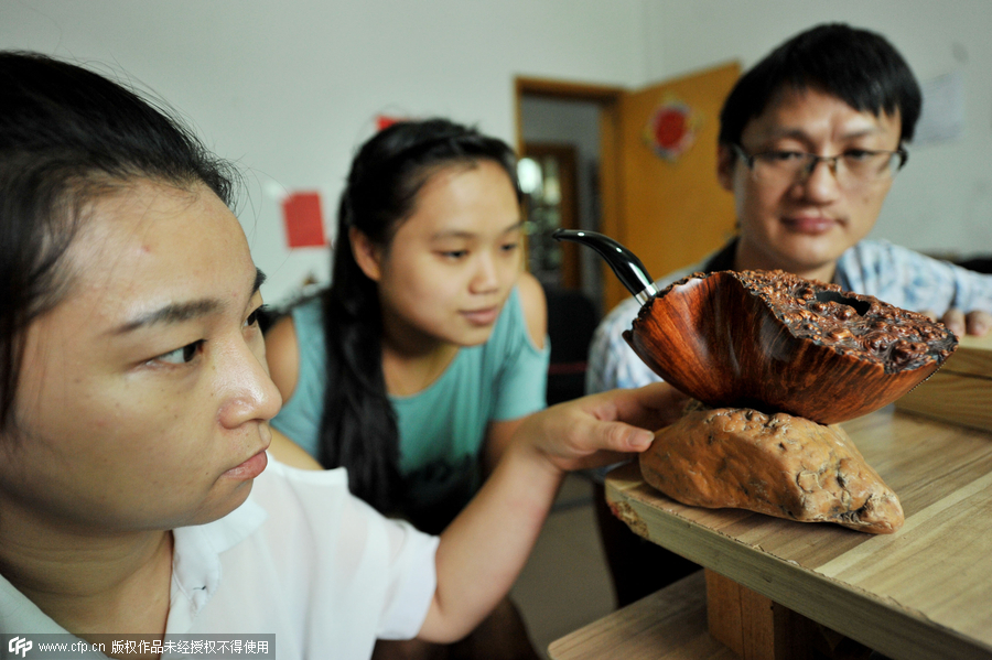 Hand crafted tobacco pipes gain traction in China