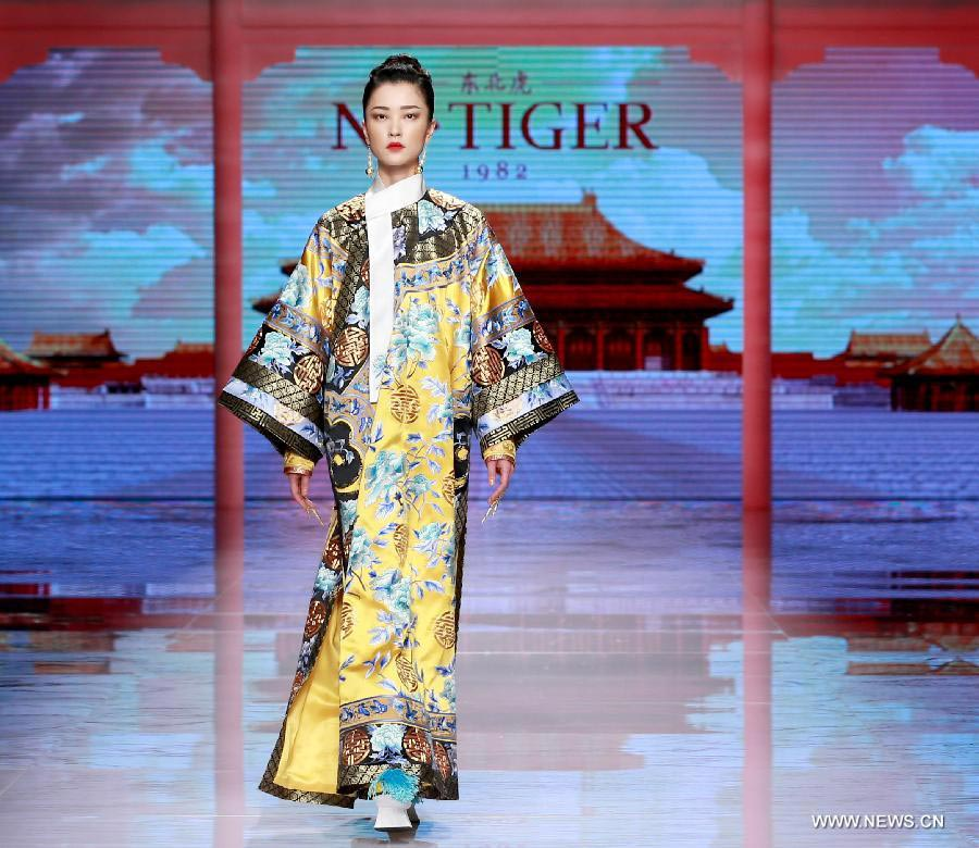 Qipaos sizzle on the runway as China Fashion Week kicks off