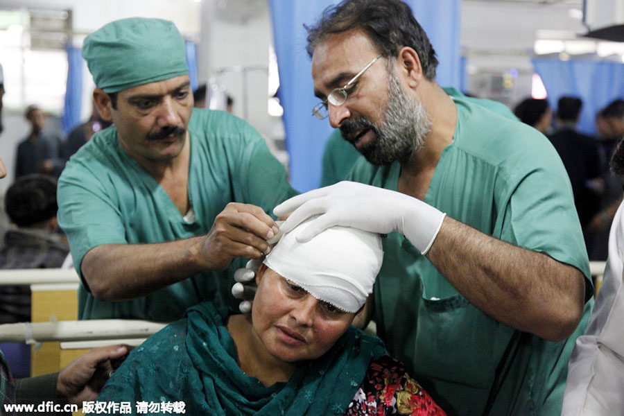 Survivors receive treatment in Pakistan after strong quake
